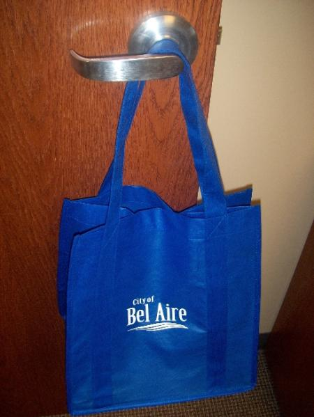 A blue grocery tote with the Bel Aire logo in white