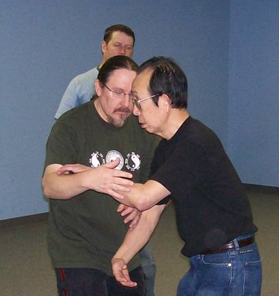 A teacher and student practicing Tai Chi