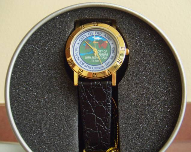 A womans watch with the logo of Bel Aire on the face