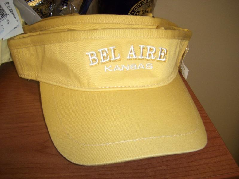 Yellow visor hat with white embroidery reading Bel Aire Kansas